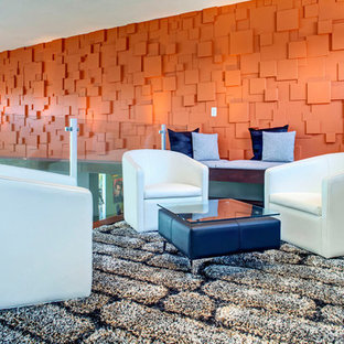 Inspiration for a contemporary loft-style family room remodel in Orange County with orange walls