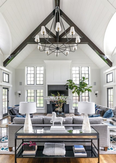Transitional Family Room by Designstorms LLC
