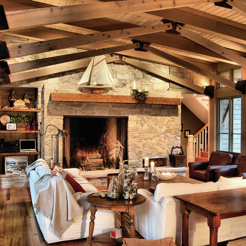 Example Of A Mountain Style Family Room Design In Chicago With Stone Fireplace Surround
