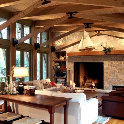 Inspiration for a rustic family room remodel in Chicago with a stone fireplace
