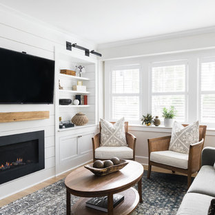 Example of a small classic open concept medium tone wood floor family room design in Boston with white walls, a standard fireplace, a wood fireplace surround and a wall-mounted tv