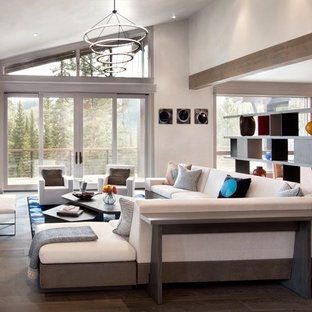 Example of a mountain style open concept dark wood floor family room design in New York with white walls, a ribbon fireplace and a wall-mounted tv