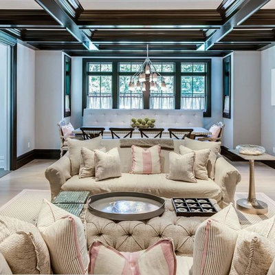 Example of a large classic enclosed light wood floor family room design in New York with no fireplace, no tv and white walls