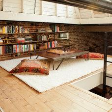 Eclectic Family Room by Capella Kincheloe Interior Design