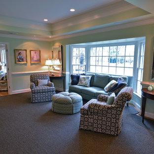 Ispirazione per un soggiorno boho chic con pareti verdi e moquette