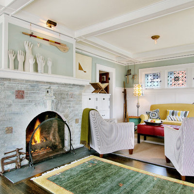 Inspiration for an eclectic dark wood floor family room remodel in Seattle with blue walls, a standard fireplace, a brick fireplace and no tv