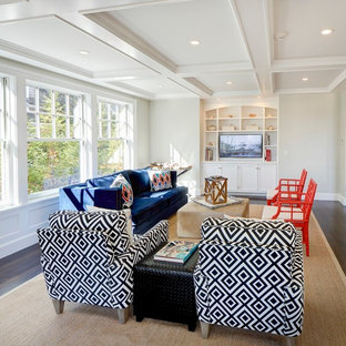 Mid-sized beach style open concept dark wood floor and brown floor family room photo in Boston with gray walls and a media wall