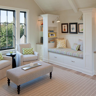 Inspiration for a mid-sized transitional open concept light wood floor and brown floor family room remodel in Grand Rapids with beige walls, no tv and no fireplace