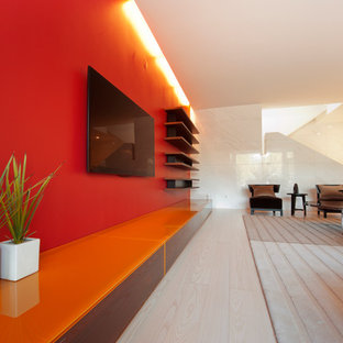 Inspiration for a huge modern open concept family room remodel in San Francisco with red walls, no fireplace and a wall-mounted tv