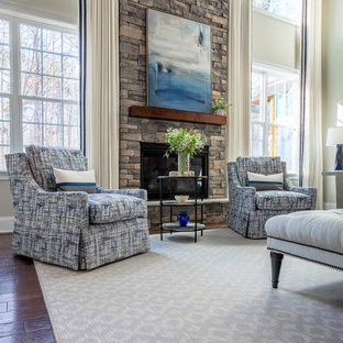 Mid-sized transitional open concept dark wood floor and brown floor family room photo in Raleigh with gray walls, a standard fireplace, a stone fireplace and a wall-mounted tv