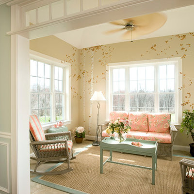 Example of a classic enclosed family room design in Boston with beige walls