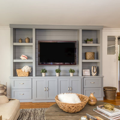 Example of a mid-sized transitional open concept medium tone wood floor family room design in Orange County with beige walls and a media wall