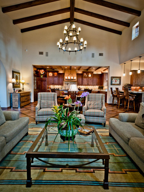 Example Of A Tuscan Open Concept Carpeted Family Room Design In Austin With Beige Walls