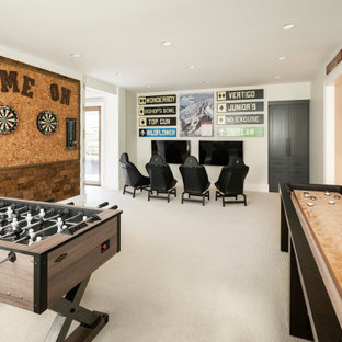 Inspiration for a large cottage beige floor and carpeted game room remodel in Salt Lake City with white walls and a wall-mounted tv