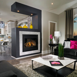 Family room - contemporary family room idea in Toronto with a two-sided fireplace
