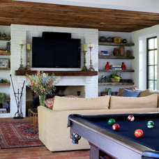 Mediterranean Family Room by Burns and Beyerl Architects
