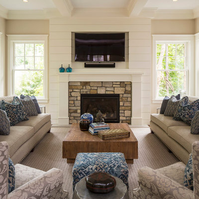 Inspiration for a timeless family room remodel in Minneapolis with beige walls, a standard fireplace, a stone fireplace and a wall-mounted tv