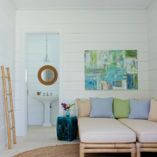 Inspiration for a small beach style family room in Miami with white walls.
