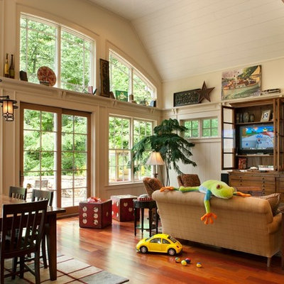 Family room - mid-sized rustic open concept medium tone wood floor and brown floor family room idea in Nashville with beige walls, no fireplace and a wall-mounted tv