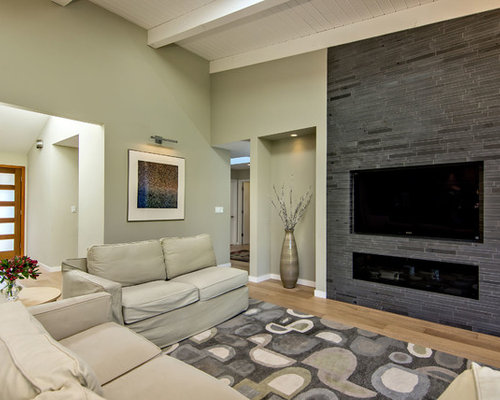 Midcentury Modern Medium Tone Wood Floor Family Room Photo In San Francisco With Beige Walls And