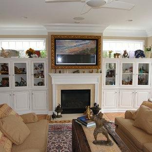 フィラデルフィアの大きいアジアンスタイルのおしゃれなファミリールーム (ミュージックルーム、ベージュの壁、淡色無垢フローリング、標準型暖炉、木材の暖炉まわり、内蔵型テレビ) の写真