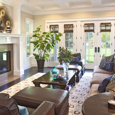 Elegant family room photo in Los Angeles with beige walls, a standard fireplace and no tv