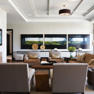 Large trendy enclosed dark wood floor family room photo in Toronto with white walls, a standard fireplace, a plaster fireplace and a wall-mounted tv