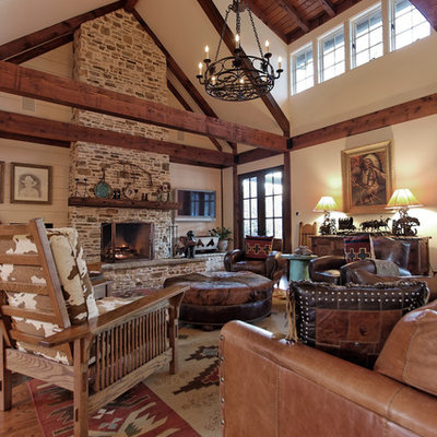 Inspiration for a rustic family room remodel in Atlanta with a stone fireplace