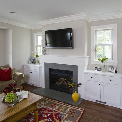 Example of a mid-sized mountain style open concept medium tone wood floor and brown floor family room design in Chicago with beige walls, a standard fireplace, a wall-mounted tv and a concrete fireplace