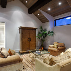 Rustic Family Room by Forum Phi - Architecture | Interiors | Planning