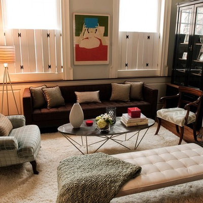 Example of an eclectic medium tone wood floor family room design in Philadelphia with beige walls, a standard fireplace and a stone fireplace