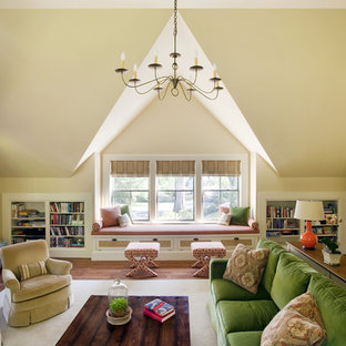 Example of a classic medium tone wood floor family room design in Boston with beige walls and no fireplace