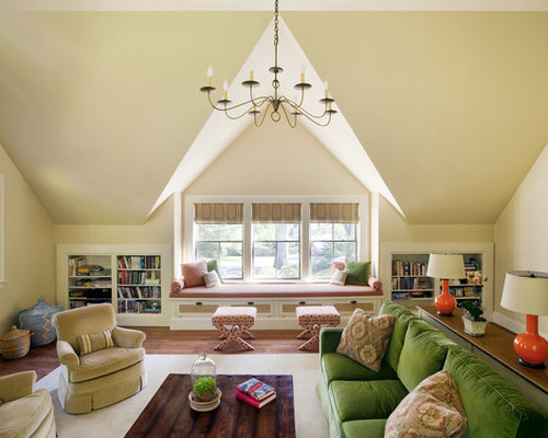 Example Of A Classic Medium Tone Wood Floor Family Room Design In Boston With Beige Walls