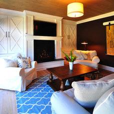 Farmhouse Family Room by JPS Construction and Design, LLC