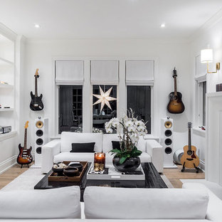 Example of a large transitional open concept light wood floor family room design in Portland with a music area, white walls, a standard fireplace and a stone fireplace