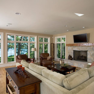 Family Room Light Hardwood Floor and Stone Fireplace with Hand Hewn Mantle Overl