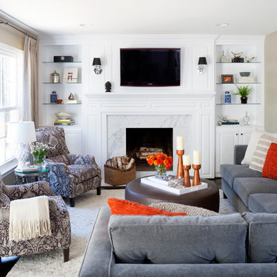 Example of a mid-sized transitional open concept brown floor and dark wood floor family room design in DC Metro with beige walls, a standard fireplace, a tile fireplace and a wall-mounted tv