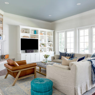 Inspiration for a mid-sized transitional enclosed dark wood floor and brown floor family room remodel in Los Angeles with a corner fireplace, a media wall, gray walls and a brick fireplace
