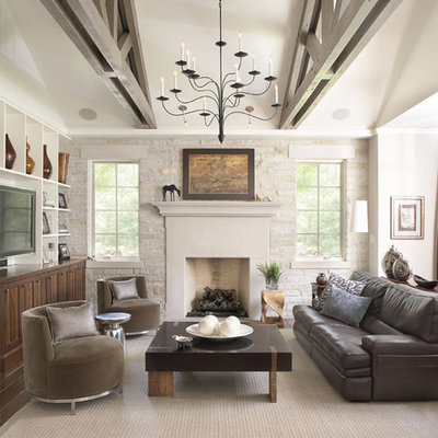 Elegant dark wood floor family room photo in Chicago with beige walls, a standard fireplace and a tv stand