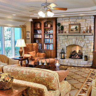 Inspiration for a large timeless family room remodel in Chicago with beige walls, a standard fireplace, a stone fireplace and a media wall