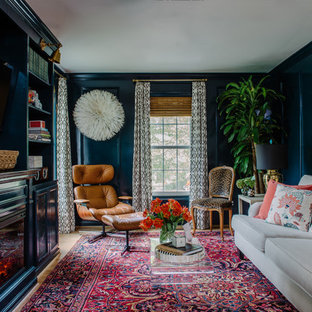 Family room - small eclectic enclosed light wood floor family room idea in DC Metro with blue walls, a standard fireplace, a wood fireplace surround and a wall-mounted tv