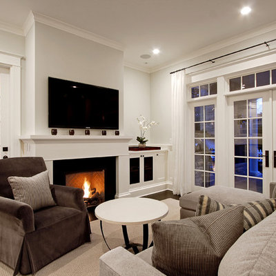 Family room - traditional family room idea in Seattle with white walls, a standard fireplace and a wall-mounted tv