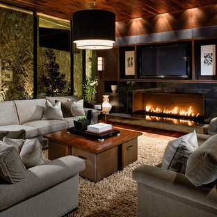 Inspiration for a contemporary dark wood floor family room remodel in Las Vegas with a ribbon fireplace and a wall-mounted tv