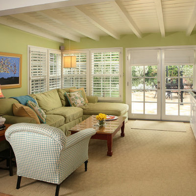 Family room - contemporary family room idea in Los Angeles with green walls
