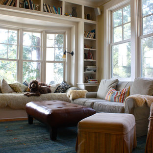 Family room library - traditional family room library idea in San Francisco with beige walls