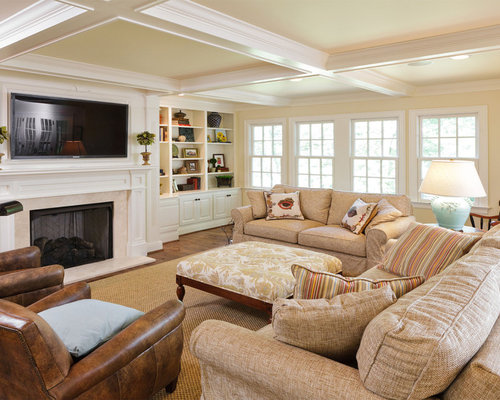 Example of a classic family room design in Louisville with beige walls   medium tone hardwood. Family Room Furniture Sets   Houzz
