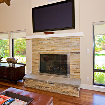 family room, stone masonry fireplace with flat TV