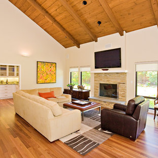 family room, stone masonry fireplace with flat TV, opens to butler pantry