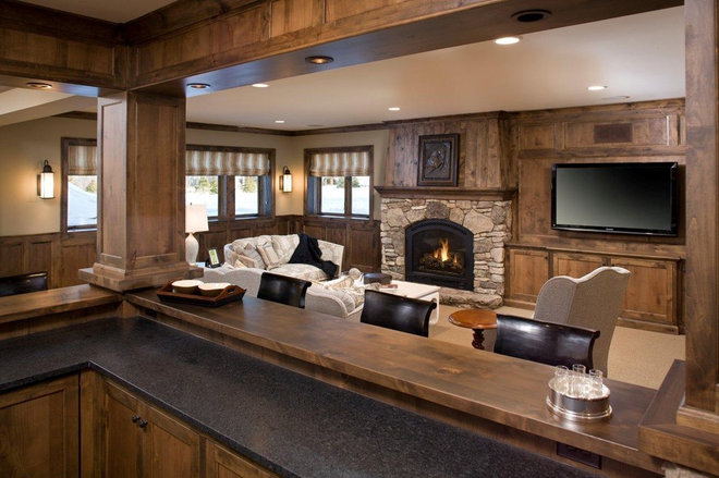 Rustic Family Room by Stonewood, LLC