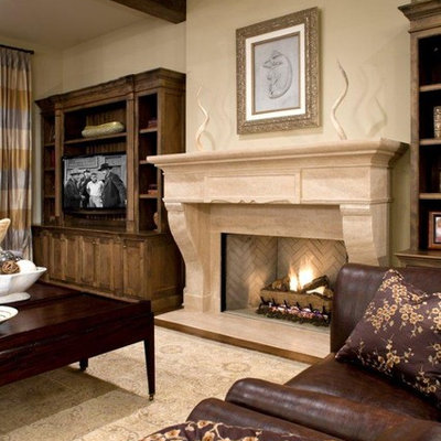 Family room - traditional family room idea in Minneapolis with beige walls, a standard fireplace and a tv stand